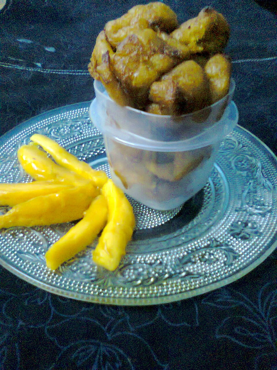 Sweet Fritters with Ripe Mangoes / Aamer Bora